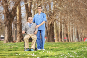 A man in a wheelchair and a caregiver