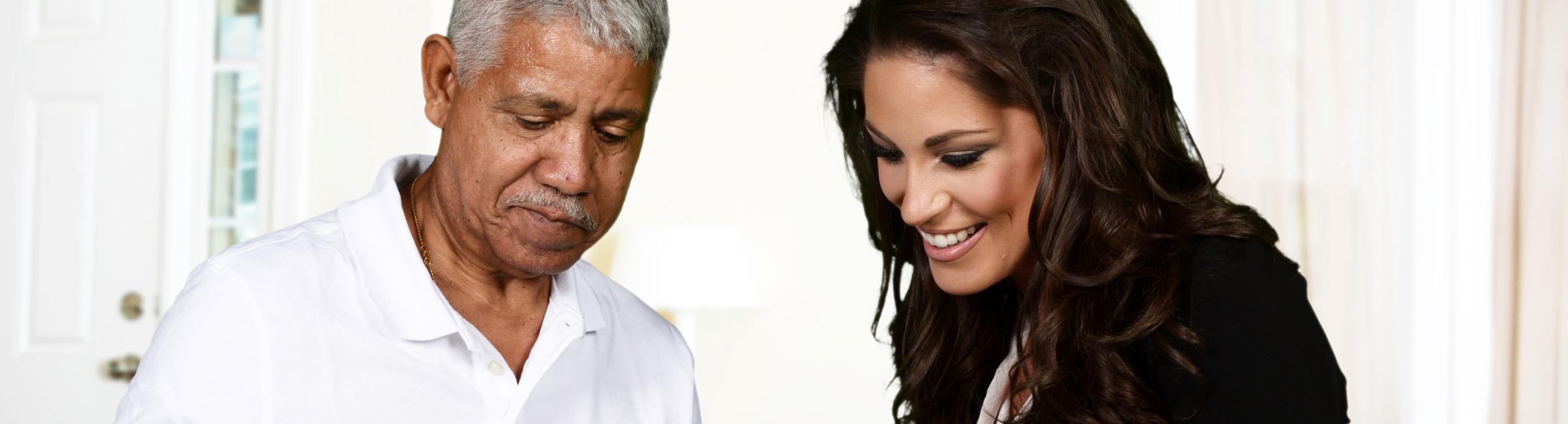 Elderly man talking his caregiver