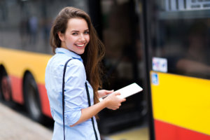 Beautiful woman going to ride a bus